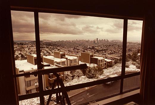 Apartment window view of snow