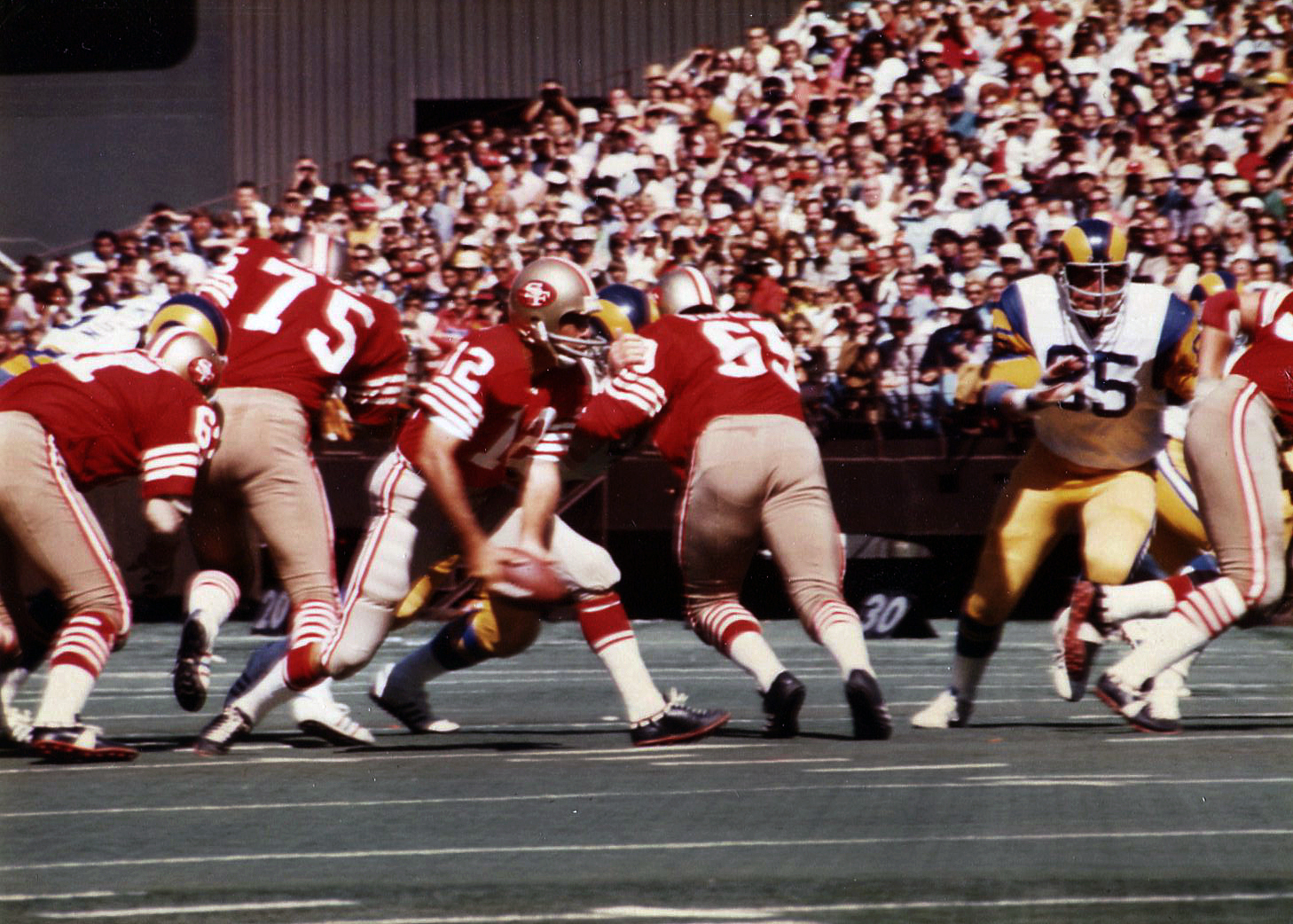 49er QB John Brodie (12) pitches out against the LA Rams in 40-13 loss.