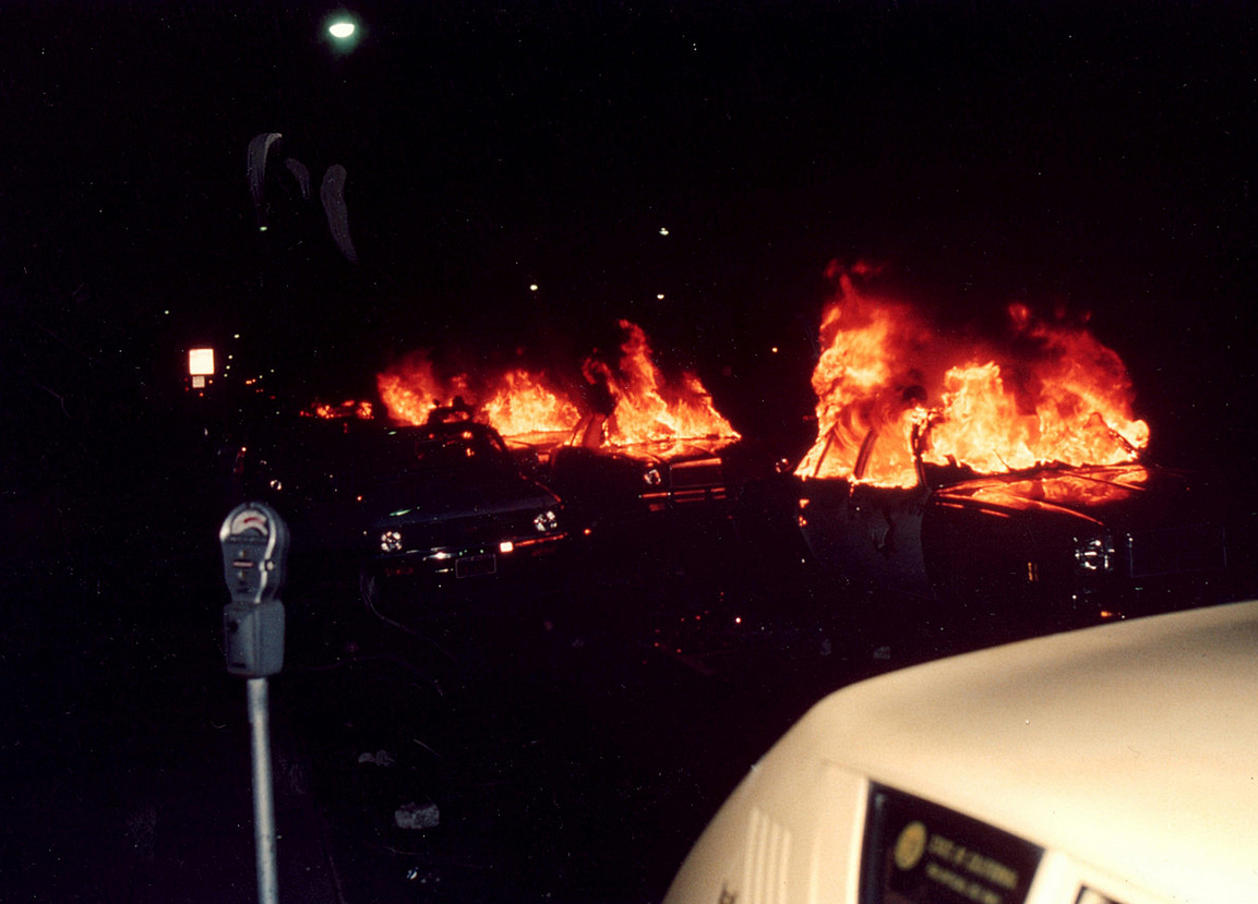 Radio cars burning in front of City Hall