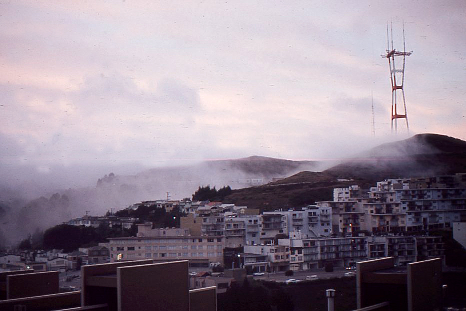 Fog rolling up Portola Blvd and the south slope of Twin Peaks.