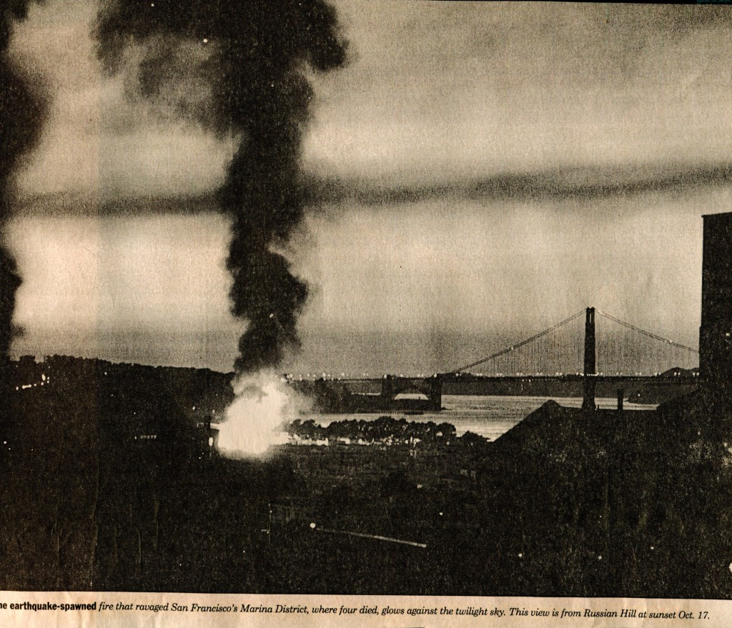 Paradox of beauty. Golden Gate Bridge at dusk and a massive fie in the Marina District. (c) SF Examiner 1989